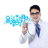 Doctor With Stethoscope And Virtual Screen Royalty Free Stock Photography