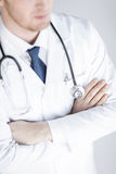 Doctor with stethoscope in white uniform. Close up of doctor with stethoscope in white uniform Stock Image