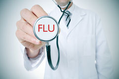 Doctor with a stethoscope with the word flu, vignetted Royalty Free Stock Photo