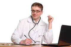Doctor with stethoscope working on a laptop Royalty Free Stock Photos