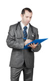Doctor with stethoscope writes diagnosis. Doctor with stethoscope hold blue folder  and writes diagnosis Royalty Free Stock Photography