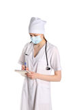 Doctor With Stethoscope Writing Down Diagnosis Stock Photo