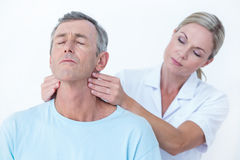Doctor stretching her patient neck Stock Image