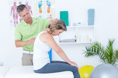 Doctor stretching his patients back Royalty Free Stock Images