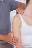Doctor stretching woman arm Stock Photography