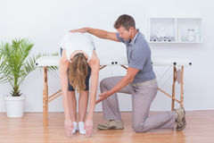 Doctor stretching a woman back royalty free stock photo