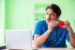 The doctor student explaining heart problems. Doctor student explaining heart problems stock image