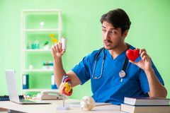 The doctor student explaining heart problems. Doctor student explaining heart problems stock photography