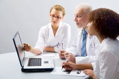 Doctor and students Royalty Free Stock Photo