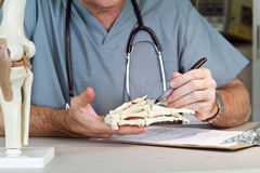 Doctor studying a hand joint Royalty Free Stock Photography