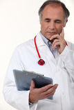 Doctor studying his patient's results Royalty Free Stock Photo