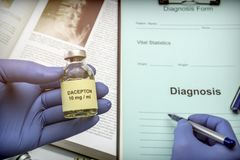 Doctor subject vial with medication for Parkinson`s disease in a hospital. Conceptual image Stock Photography
