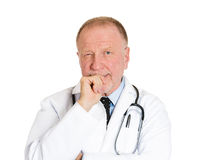 Doctor sucking thumb, deep thinker Stock Images