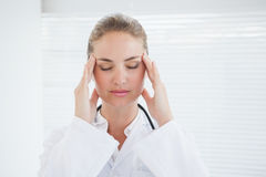 Doctor suffering from a migraine Royalty Free Stock Photo