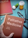 Doctor supports a book of alternative medicine in a medical laboratory Royalty Free Stock Images