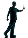 Doctor surgeon Anesthetist man holding surgery needle silhouette Royalty Free Stock Photos