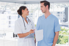 Doctor and surgeon chatting together Stock Photo