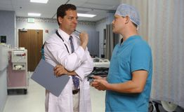 Doctor and surgeon consulting Royalty Free Stock Photography