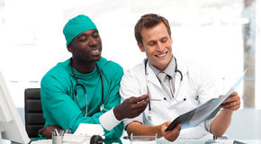 Doctor and surgeon looking at an xray Stock Image