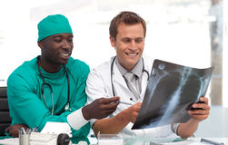 Doctor and surgeon looking at an xray Stock Photos