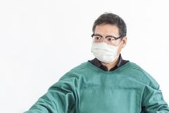 Doctor surgeon man with green clothes on white background. royalty free stock images