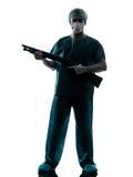 Doctor surgeon man holding shotgun Royalty Free Stock Photos