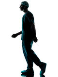 Doctor surgeon man walking silhouette Royalty Free Stock Images