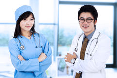 Doctor and a surgeon in pose Stock Photo