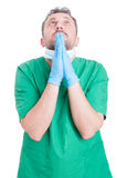 Doctor or surgeon praying Royalty Free Stock Photo