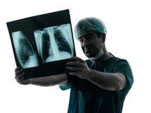 Doctor surgeon radiologist examining lung torso  x-ray image Royalty Free Stock Photo