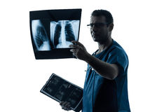 Doctor surgeon radiologist examining lung torso  x-ray image Stock Photography