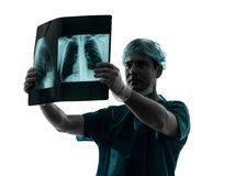 Doctor surgeon radiologist examining lung torso  x-ray image Royalty Free Stock Photo