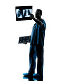 Doctor surgeon radiologist examining lung torso  x-ray image sil Stock Photography