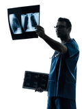 Doctor surgeon radiologist examining lung torso  x-ray image sil Royalty Free Stock Images