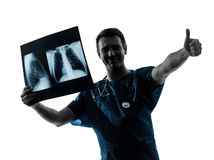 Doctor surgeon radiologist examining x-ray image Stock Photo