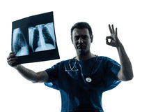 Doctor surgeon radiologist gesturing okay examining lung torso Stock Photos