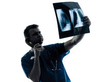 Doctor surgeon radiologist phone examining x-ray Royalty Free Stock Image