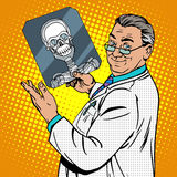 Doctor surgeon x-rays skull Royalty Free Stock Photo