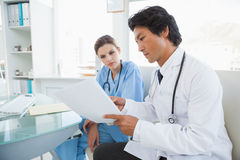 Doctor and surgeon reading notes Royalty Free Stock Photo