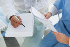 Doctor and surgeon reviewing notes Stock Photography
