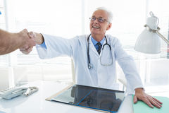Doctor and surgeon shaking hands Royalty Free Stock Photo