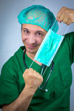 Doctor surgeon stretches surgical mask Stock Photography