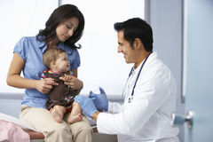 Doctor In Surgery Examining Baby Girl Royalty Free Stock Photography