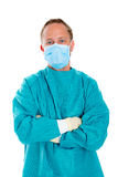 Doctor with surgical mask and green coat Royalty Free Stock Photos