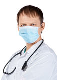 Doctor with surgical mask and stethoscope Stock Images