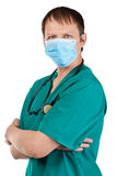 Doctor with surgical mask and stethoscope Royalty Free Stock Photos