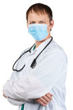 Doctor with surgical mask and stethoscope Stock Image