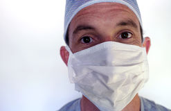 Doctor in surgical mask with surprised expression Royalty Free Stock Photos