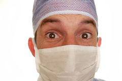 Doctor in surgical mask with surprised expression Royalty Free Stock Image