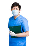 Doctor with surgical uniform hold clipboard Stock Image
